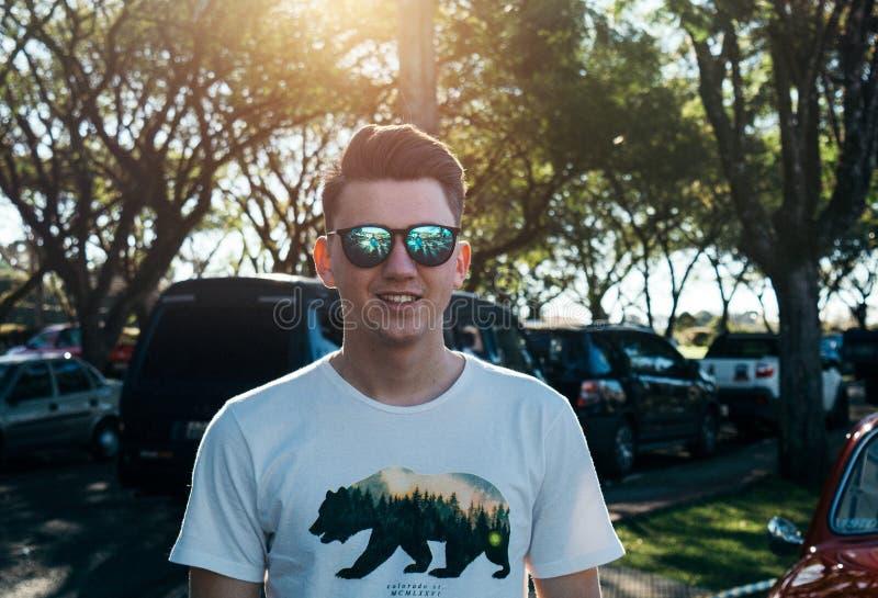 Man Wearing White and Black Bear Printed Shirt and Sunglasses royalty free stock photo