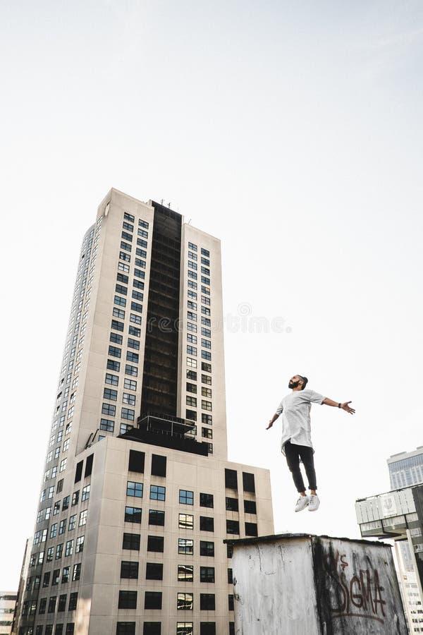 Man Wearing White Long Sleeve Shirt Beside White And Black High Rise Building Free Public Domain Cc0 Image