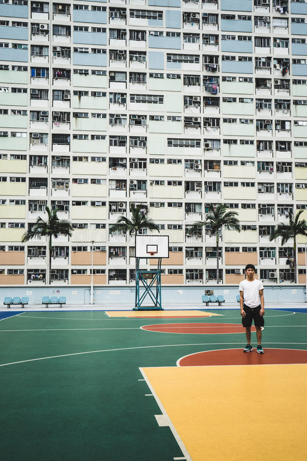Man Wearing White Shirt Standing In Front Of High Rise Building At Daytime Free Public Domain Cc0 Image