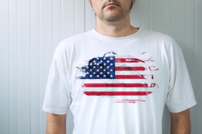 Man wearing white shirt with USA flag print royalty free stock image