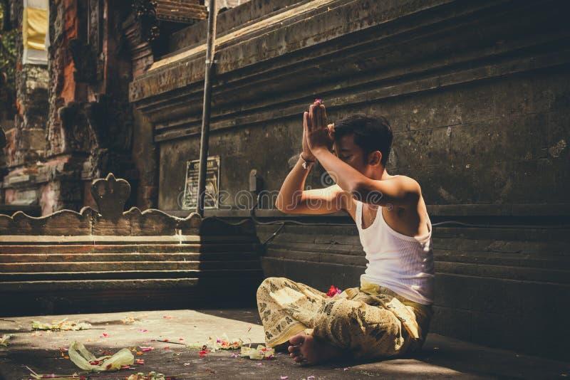 Man Wearing White Tank Top Praying royalty free stock photography