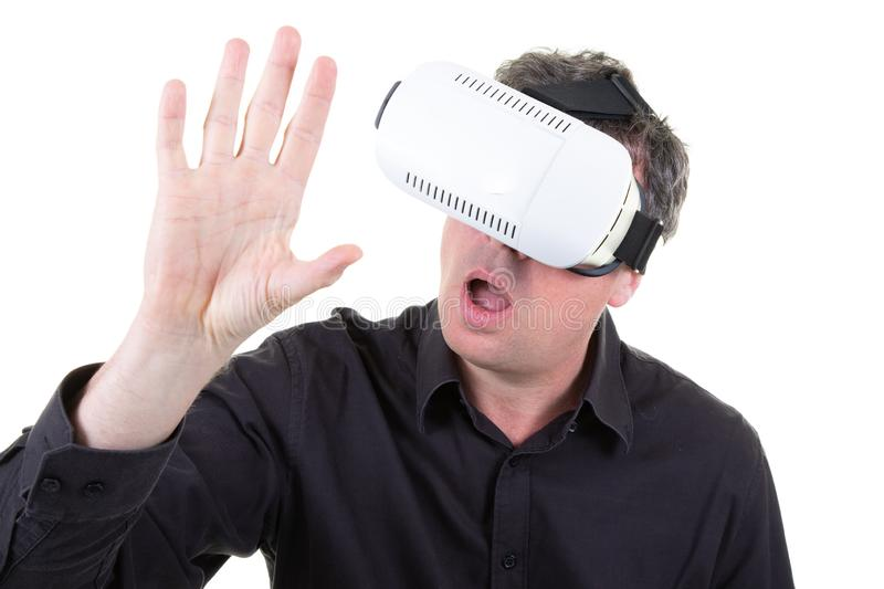 Man wearing white virtual reality headset having great fun royalty free stock image