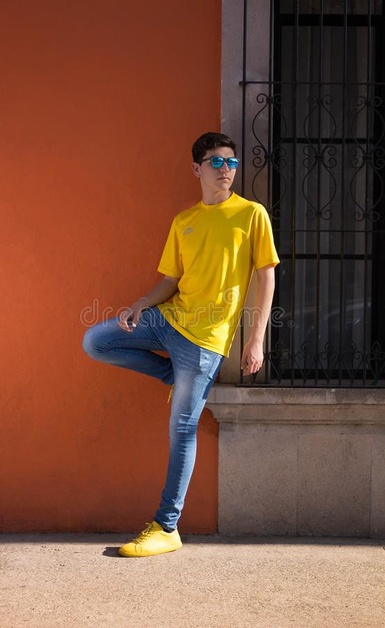 Man Wearing Yellow Crew-neck T-shirt and Blue Denim Jeans royalty free stock photos