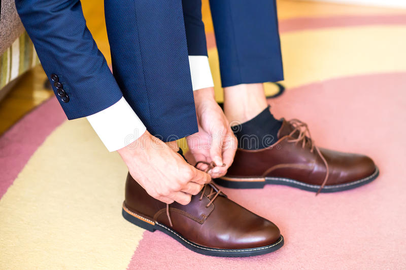 The man wears shoes royalty free stock photo