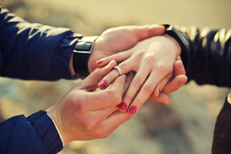 Man Wears A Wedding Ring On Womans Hand Stock Image Image of