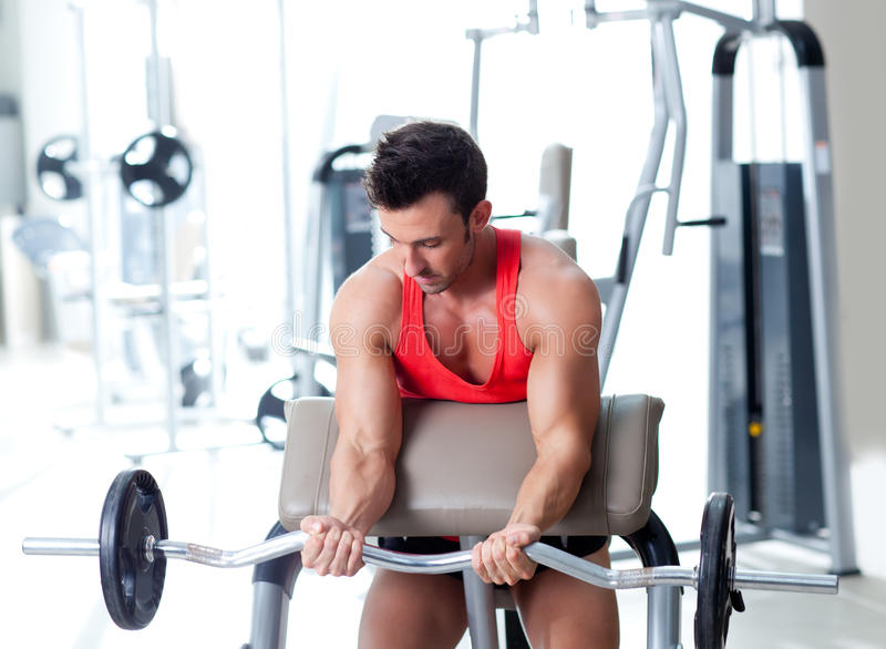 Man with weight training equipment on sport gym stock images