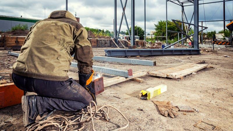 Man welder working stock images
