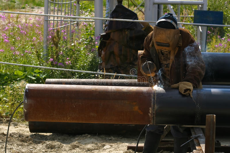 Download Man welding the pipe stock image. Image of pipeline, equipment - 12978261