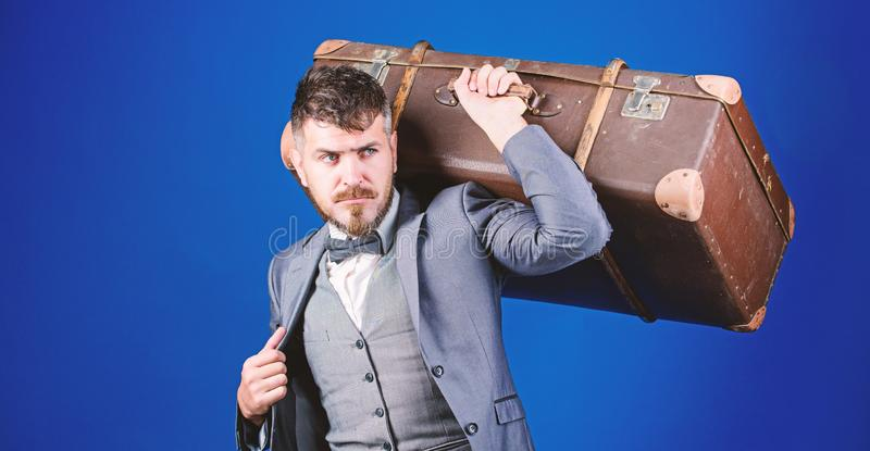Man well groomed bearded hipster with big suitcase. Take all your things with you. Heavy suitcase. Delivery service royalty free stock images