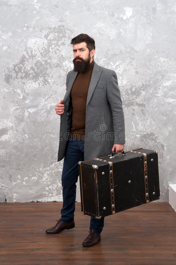 Man well groomed bearded hipster with big suitcase. Travel and baggage concept. Hipster traveler with baggage. Ready for. Relocation with baggage. Start journey royalty free stock images