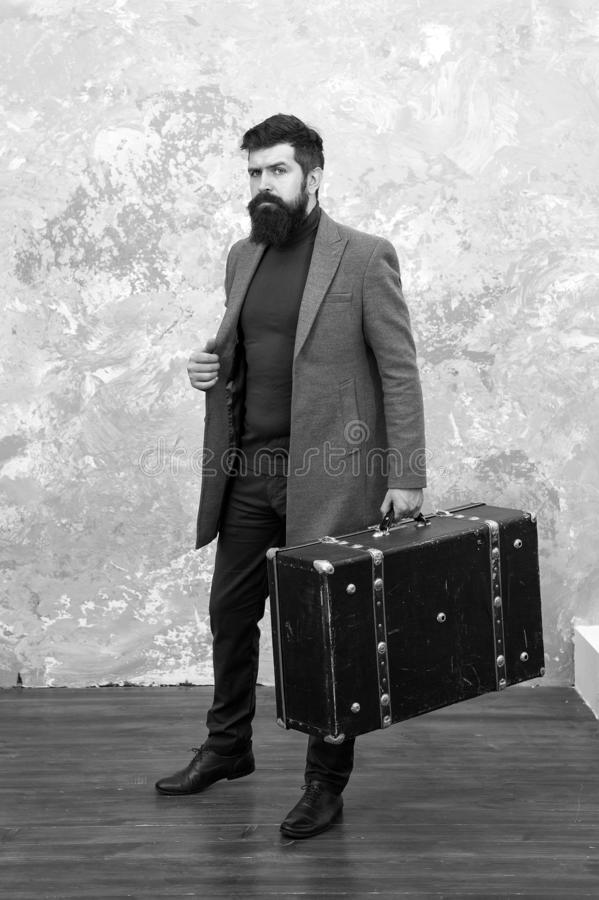 Man well groomed bearded hipster with big suitcase. Travel and baggage concept. Hipster traveler with baggage. Ready for. Relocation with baggage. Start journey royalty free stock image