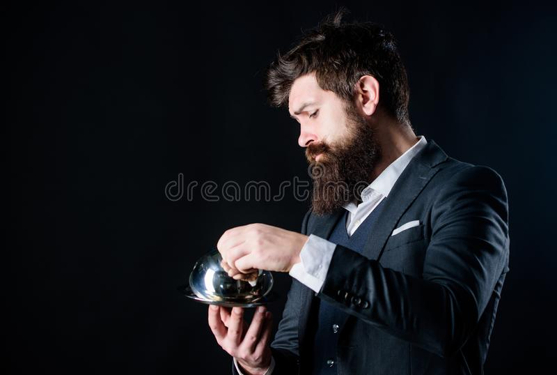Man well groomed gentleman formal suit hold little cloche. Serving and presentation. Elite luxurious. Secret under royalty free stock image