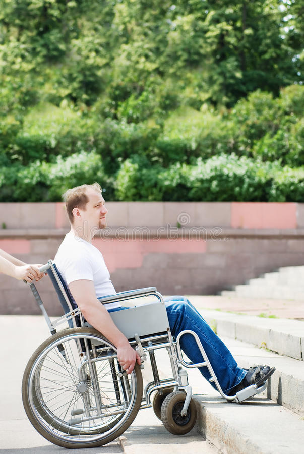 Man in a wheelchair royalty free stock image