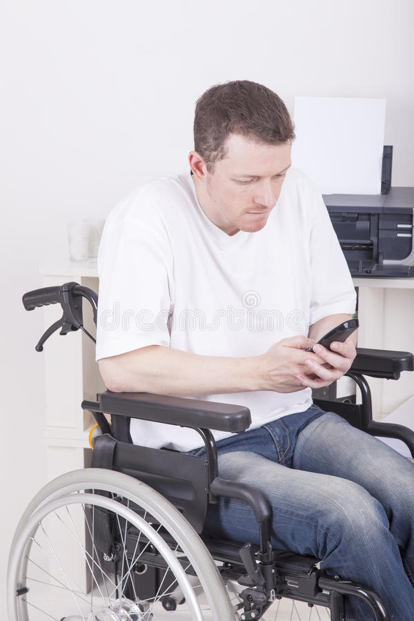 Man in wheelchair royalty free stock images