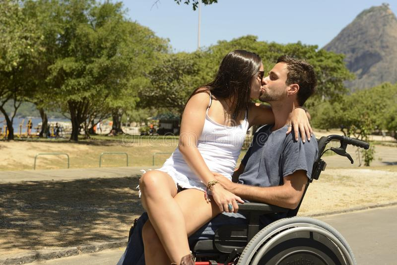 Man in wheelchair and girlfriend royalty free stock photo