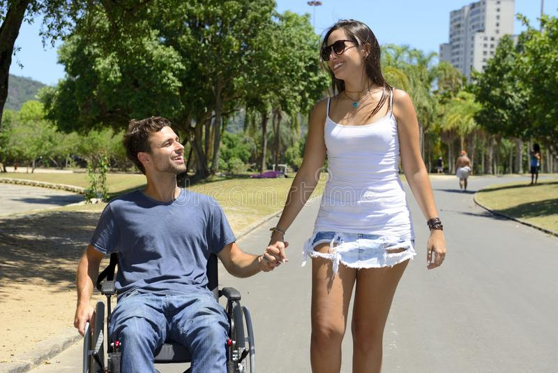 Man in wheelchair and girlfriend stock photos