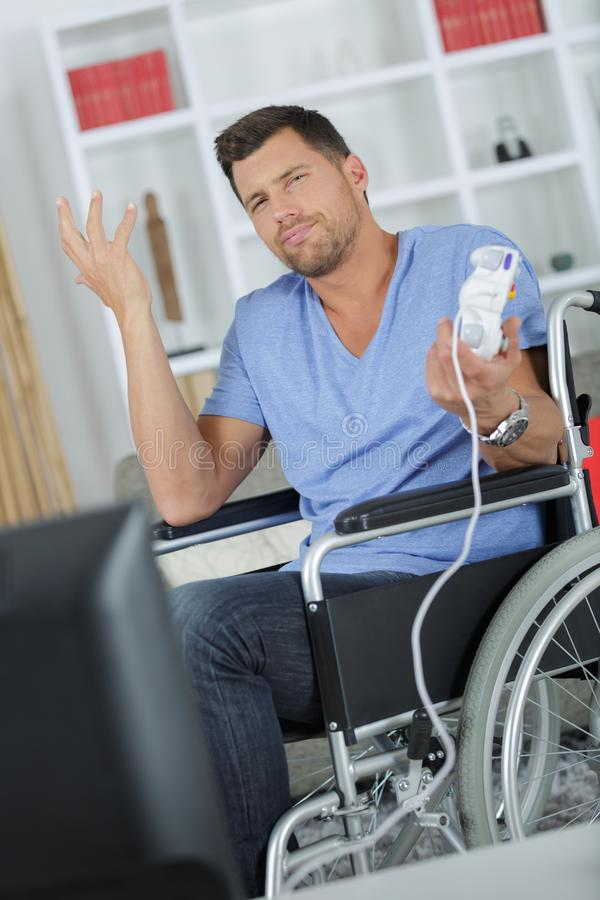 Man in wheelchair making nonchalant gesture stock image