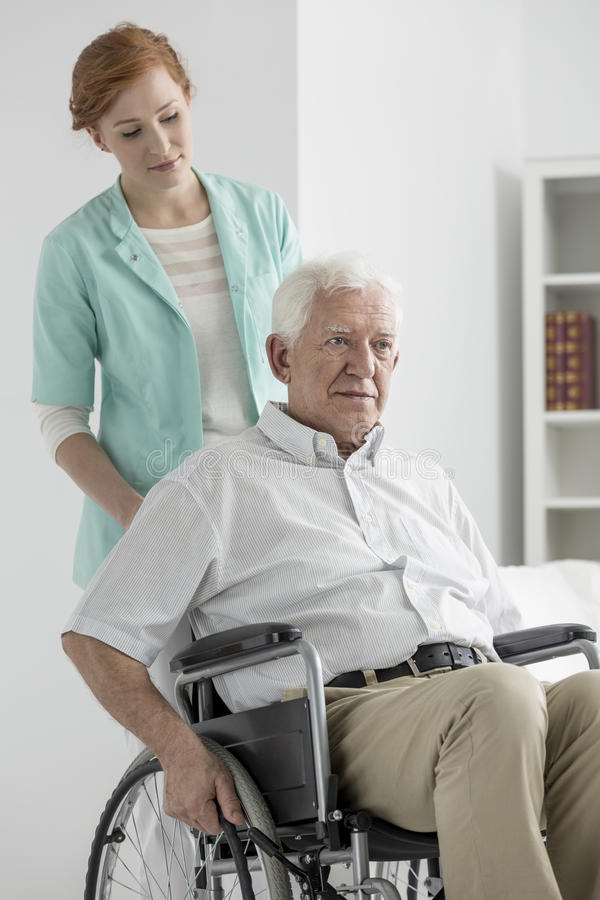 Man on a wheelchair royalty free stock photography