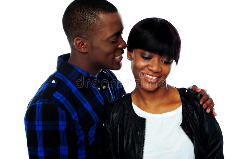 Download Man Whispering In Girlfriends Ear Stock Image - Image: 25231343