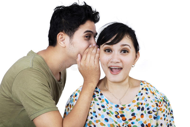 A man whispering a secret news stock photos