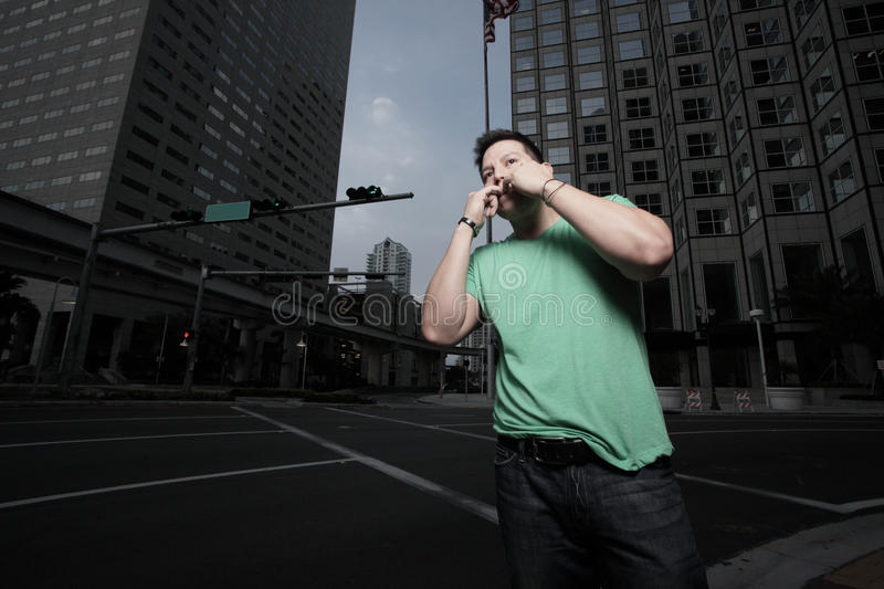 Download Man whistling for a cab stock image. Image of shirt, hailing - 13236811