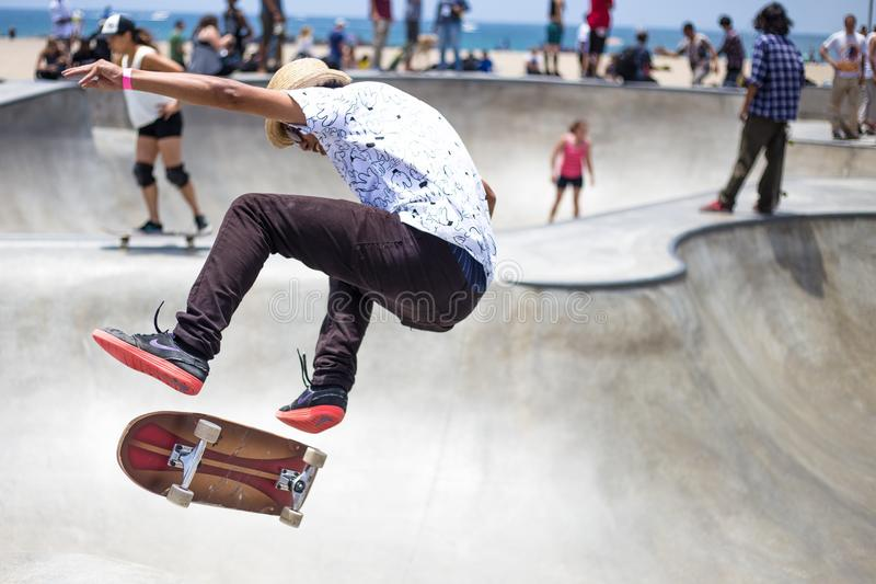 Man In White And Black Floral Shirt Riding On Brown And Red Skateboard Free Public Domain Cc0 Image