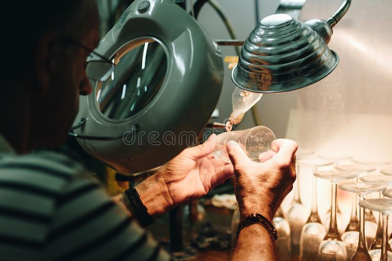 Man in White and Black Stripes Top While Making Drinking Glasses Using Grey Machine royalty free stock photography