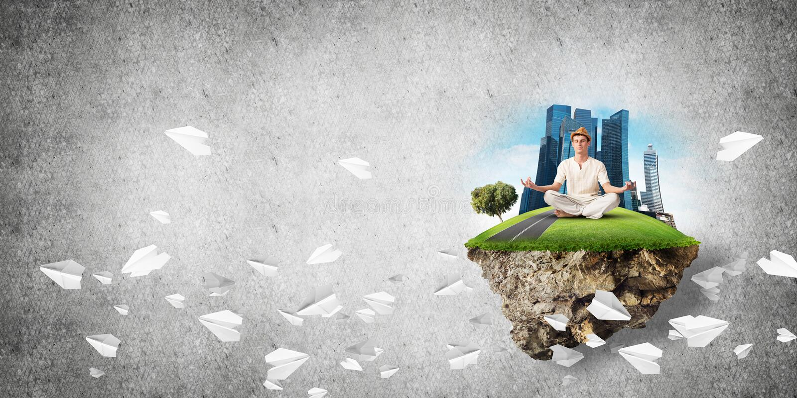 Young man keeping mind conscious. Man in white clothing keeping eyes closed and looking concentrated while meditating on island in the air among flying paper royalty free illustration