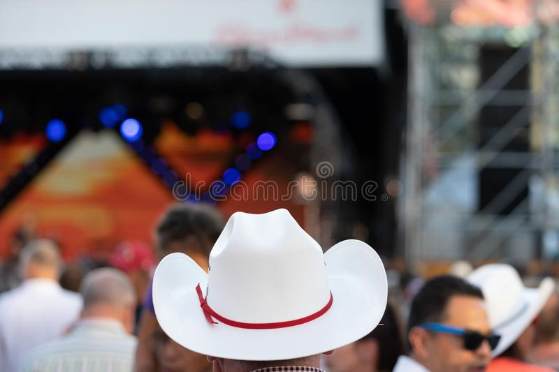 Cowboy hat in focus at the Calgary Stampede royalty free stock images