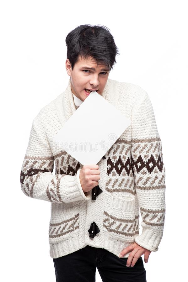 A man with a white drawing paper stock photography