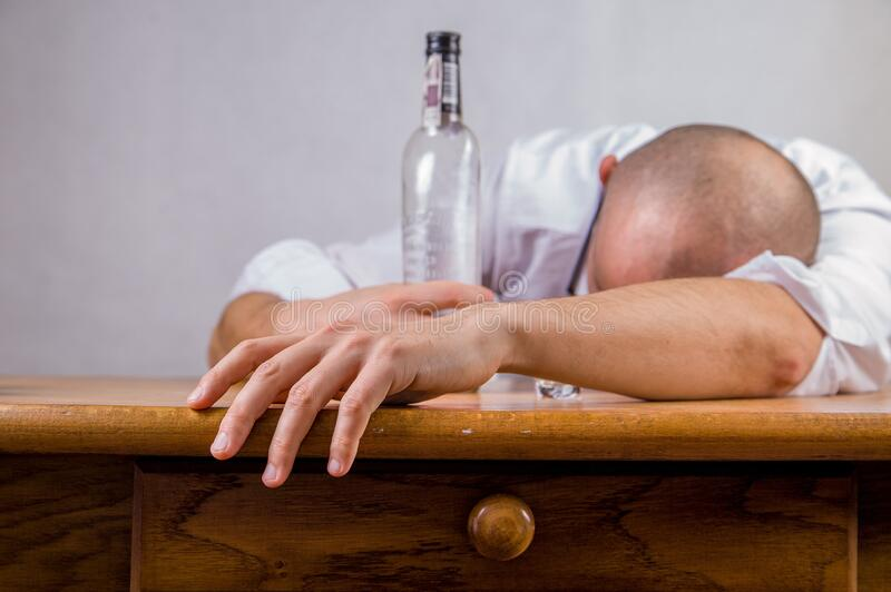 Man In White Dress Shirt Holding Glass Bottle On Brown Wooden Table Free Public Domain Cc0 Image