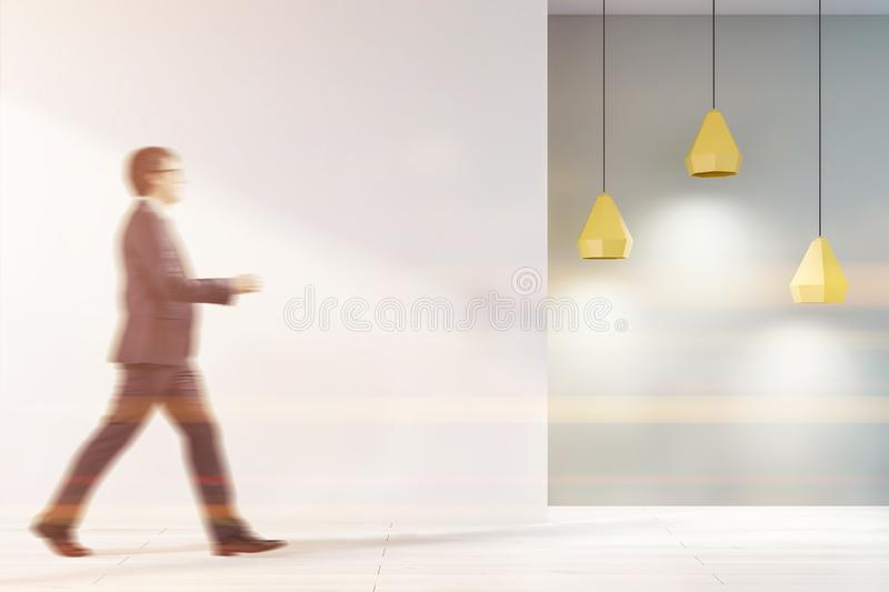Man in white and gray empty room interior stock photography