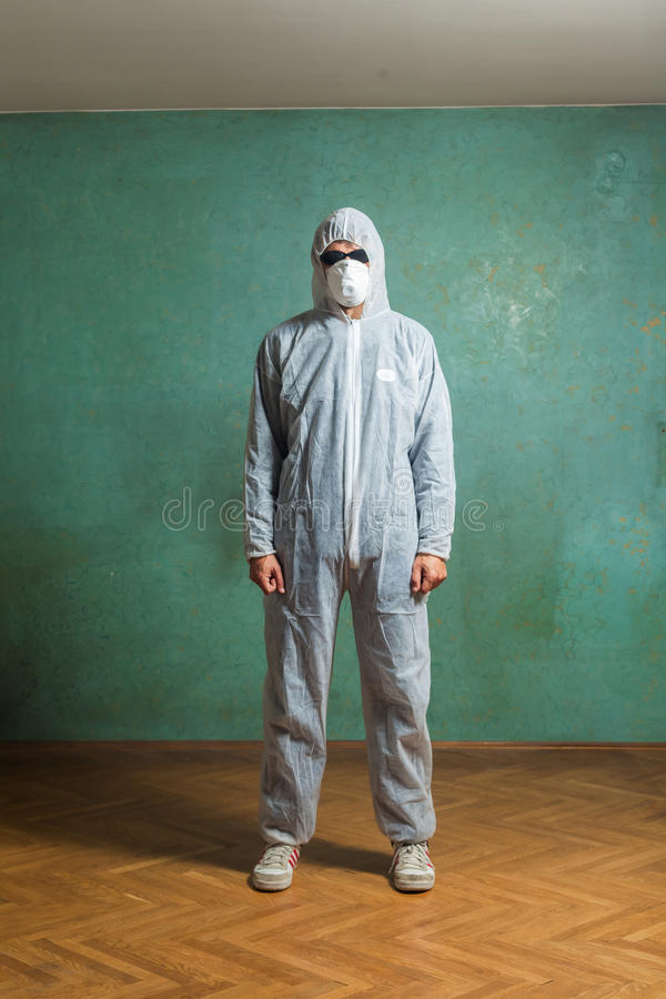 The man in white jumpsuit stock image