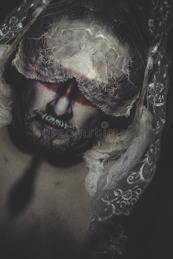 Man with white lace veil, mystery, nightmares royalty free stock photo