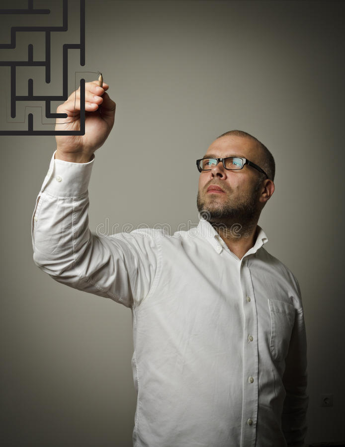 Man in white and maze. royalty free stock images