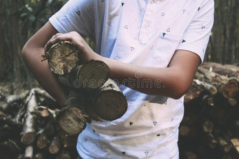 Man In White Polo Shirt Carrying On His Right Firewood Sticks Free Public Domain Cc0 Image
