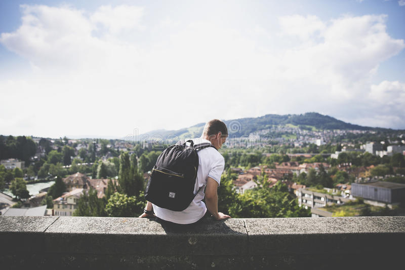 Man In White Shirt With Black Backpack Sitting During Daytime Free Public Domain Cc0 Image
