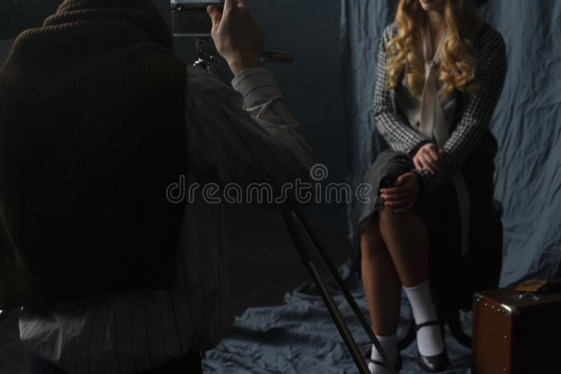Photographer working with model in studio, vintage royalty free stock images