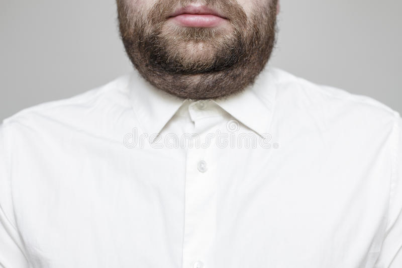 Man in a white shirt with a double chin royalty free stock photography