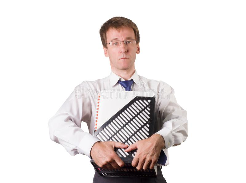 A man in a white shirt and tie holds a package with accounting documents. Isolated. White young man stock image