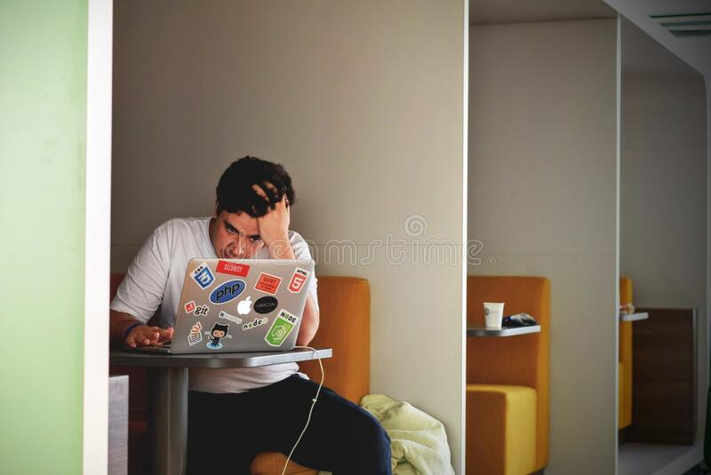 Man in White Shirt Using Macbook Pro stock photos