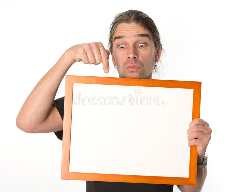 Man with white signboard. Man is showing on a white signboard royalty free stock image