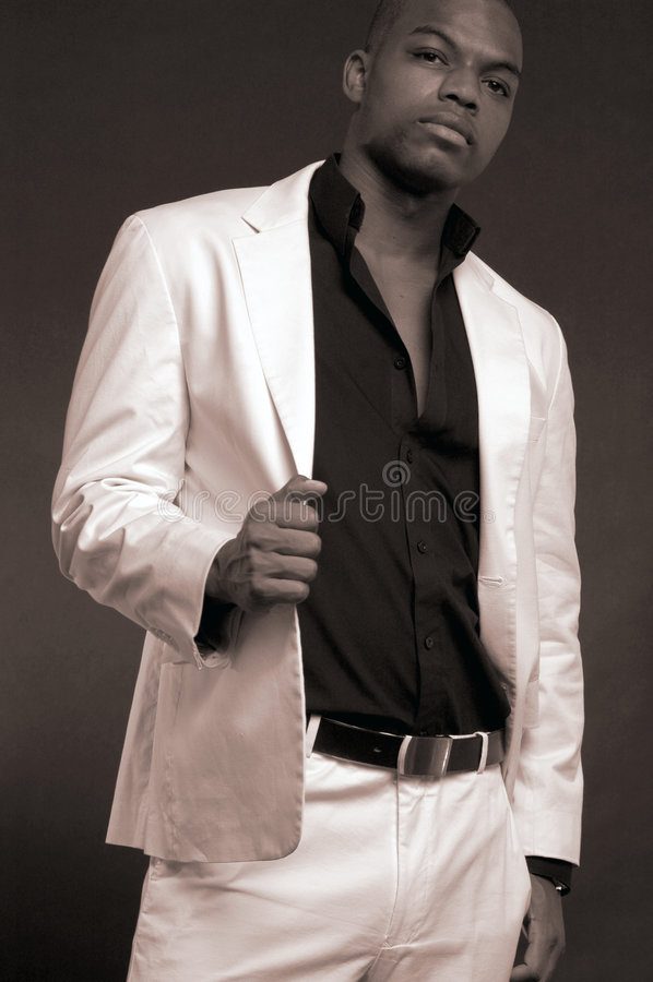 Man in a white suit royalty free stock photo