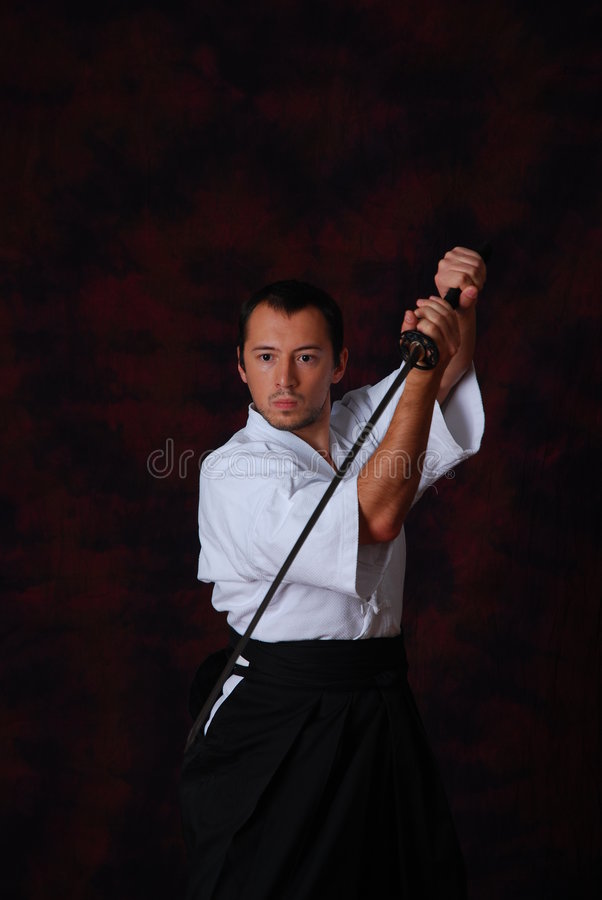 Man In White With Sword Royalty Free Stock Photos