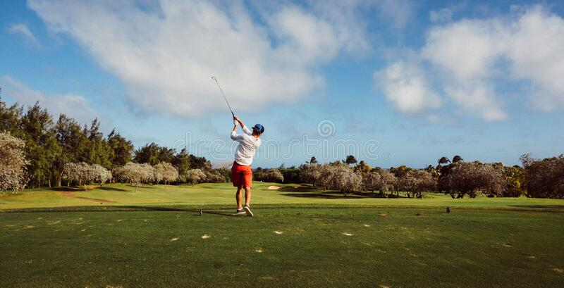 Man in White T Shirt Playing Golf royalty free stock photos