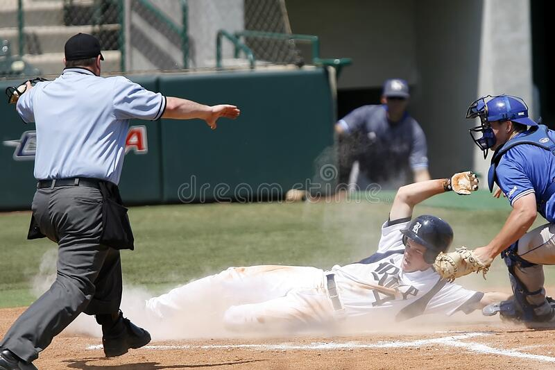 Man With White T Shirt Running to Baseball Home royalty free stock photos
