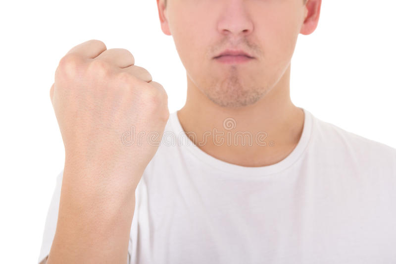 Man in white t-shirt showing his fist isolated on white. Background stock images