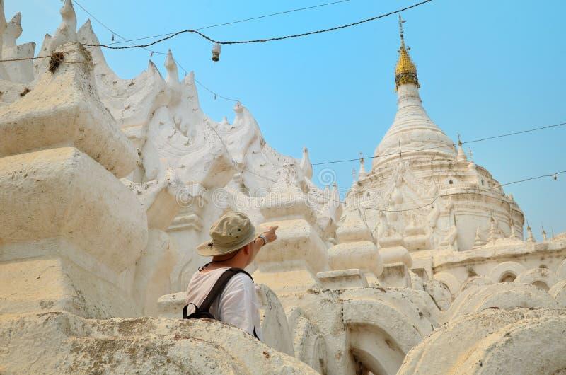 Man in white temple in Mandalay. The white pagoda of Hsinbyume Mya Thein Dan pagoda paya temple Mingun Mandalay Myanmar stock photos