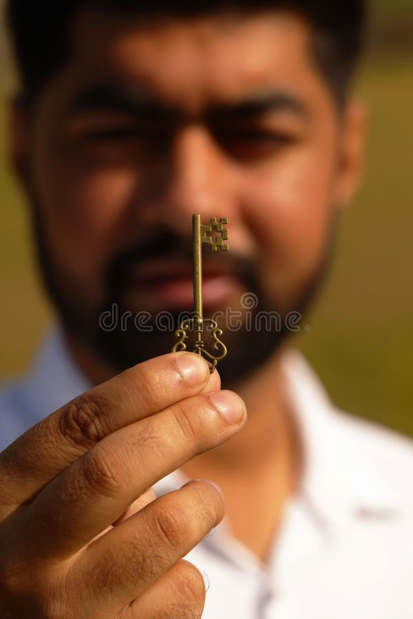 Key of luck. Man who holds the key of luck royalty free stock photos
