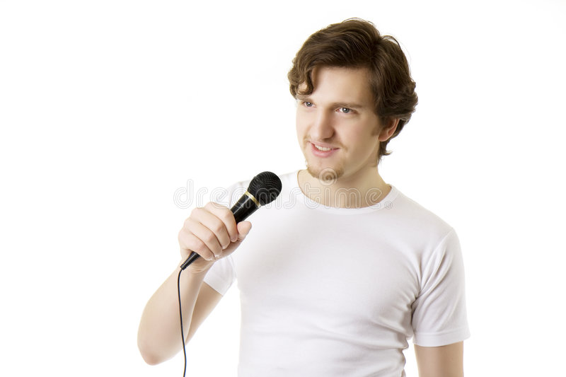 Man who sings in the microphone stock photography